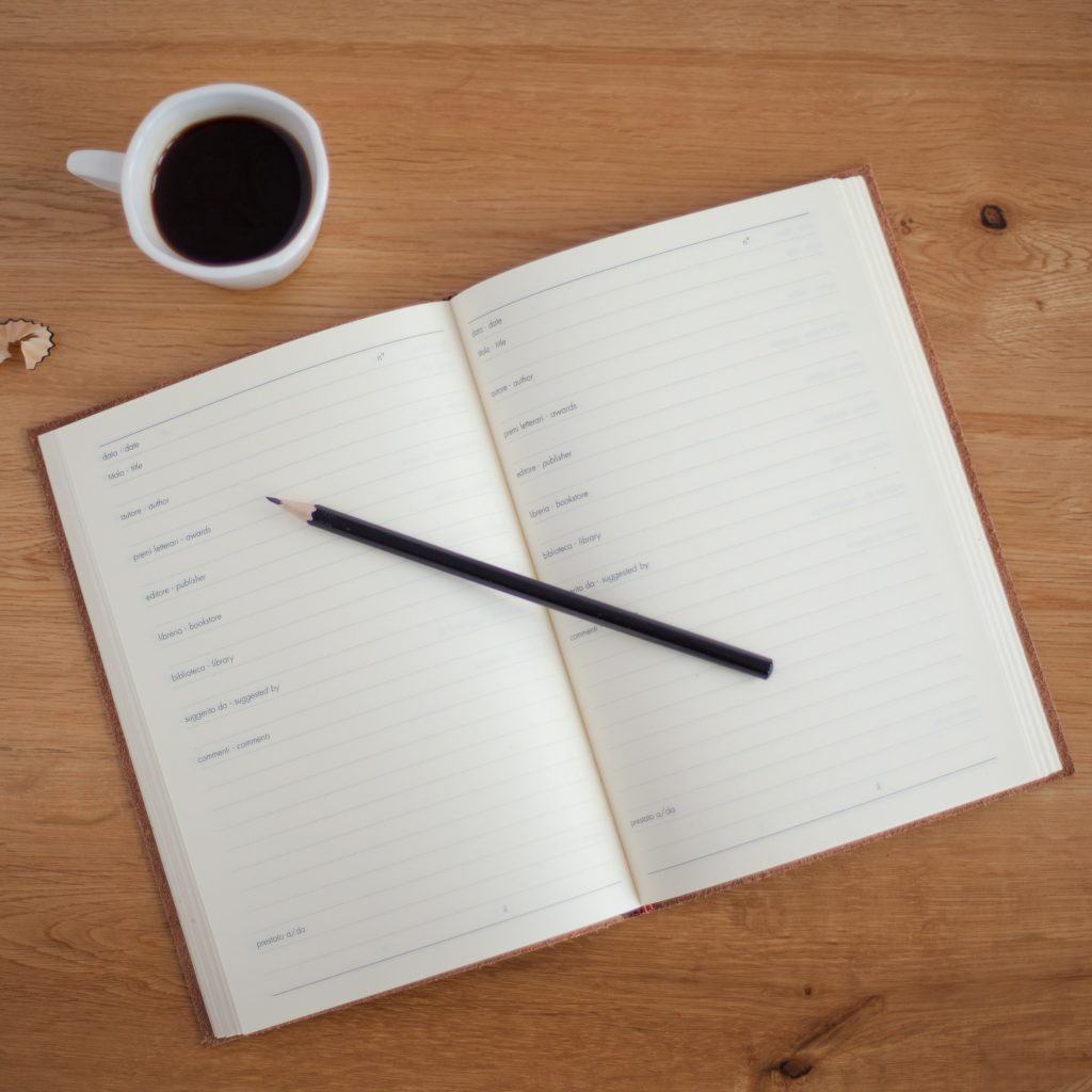 blank calendar page with coffee cup and pencil