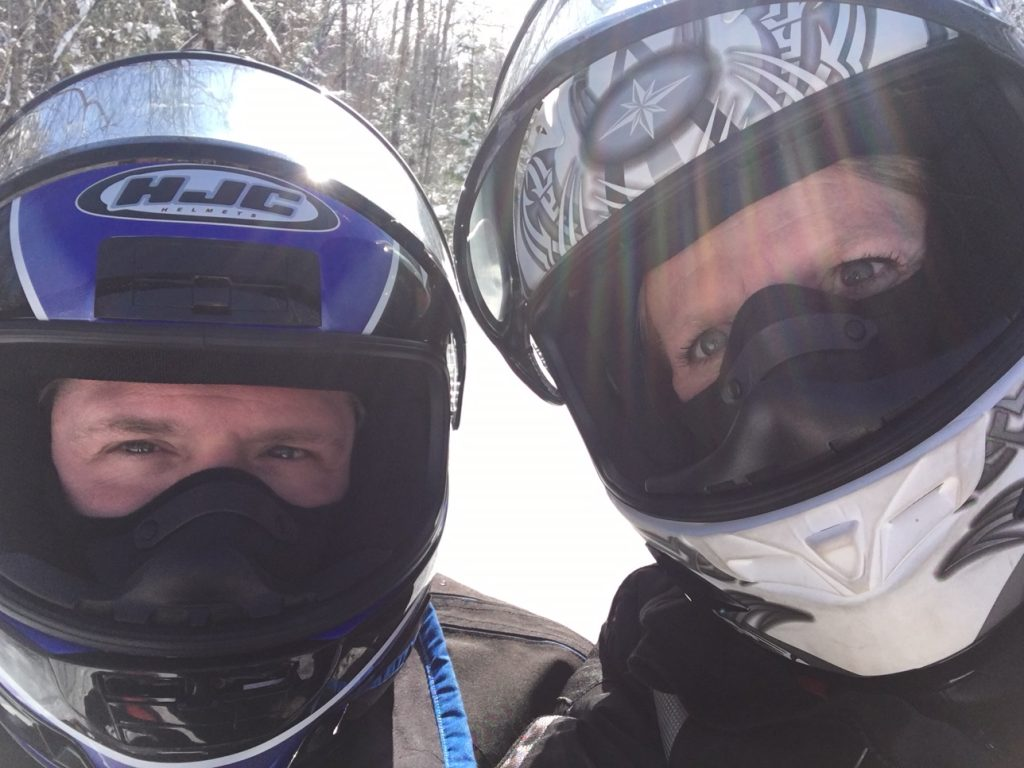 michelle koch in snowmobile helmet with husband Steve